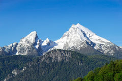 Snow-capped mountain peaks Watzmann Mount in national park Berchtesgaden. Snow-capped top mountain peaks of Watzmann Mount ridge in German Bavarian Alps. View to Royalty Free Stock Images