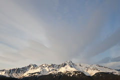 Snow capped mountain range Stock Images