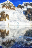 Snow capped Mountain Reflections Stock Image