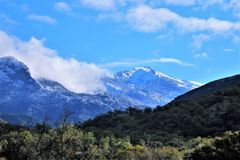 Snow capped mountain and valley. Snow capped mountain at end of valley. Mountain is in Sequoia National Park Royalty Free Stock Images