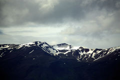 Snow capped mountains. In Iceland Royalty Free Stock Photo