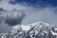 Snow-capped mountains Stock Images