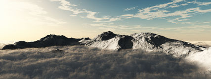 Snow-capped mountains above the clouds. Panoramic view of a mountains above the clouds Royalty Free Stock Photography