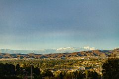 Snow capped mountains above the hills of Anaheim California. A beautiful Scene highlighted by a beautiful blue sky royalty free stock photos