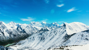 Snow-capped mountains against the blue sky in Altai Republic Stock Images