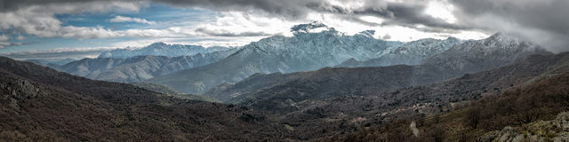 Snow capped mountains in Balagne region of Corsica Stock Photos