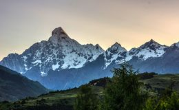 The snow capped mountains. Beautiful scenery in the early morning Royalty Free Stock Photography