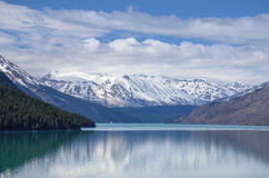 Snow-capped Mountains and Blue Lake Stock Photography