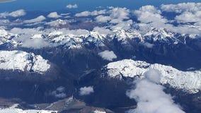 Snow-capped mountains. Snow-capped, mountains, blue sky, clouds, bird& x27;s view Stock Image