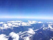 Snow-capped mountains. Snow-capped, mountains, blue sky, clouds, bird& x27;s view Stock Photos