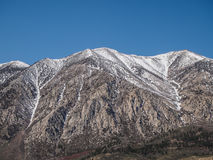 Snow capped mountains, blue sky, Desert landscape Royalty Free Stock Images