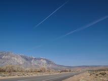 Snow capped mountains, blue sky, Desert landscape Stock Photo