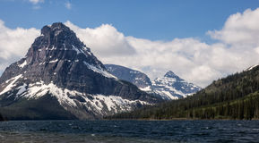Snow capped mountains and clear lake Stock Photos