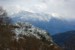 Snow-capped mountains. Snow-covered mountain massif Orjen (Montenegro Royalty Free Stock Images