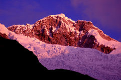 Snow-capped mountains at dusk Royalty Free Stock Photos