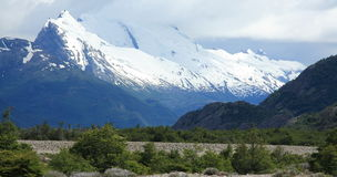 Snow capped mountains, El Chalten, Argentina. Snow capped mountains in the distance on the Piedra del Fraile trail alongside Rio Electrico in Los Glaciares stock photography
