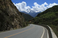 Snow-capped mountains and highway Royalty Free Stock Images