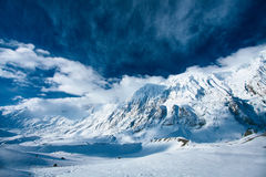 Snow capped mountains Stock Images