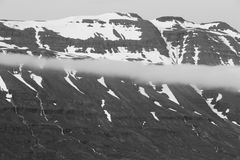 Snow-capped mountains in Iceland. Panorama of snow-capped mountains in Seydisfjordur, Iceland Royalty Free Stock Images