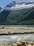 Snow capped mountains at lake Stock Photography