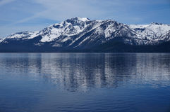 Snow-capped mountains of Lake Tahoe. Photo of show-capped mountains in beautiful Lake Tahoe located in Nevada & California in the United States. Beautiful water Stock Image