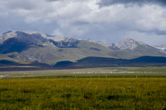 Snow-capped mountains and the plains Royalty Free Stock Photo