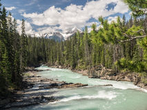 Snow capped mountains and river valley Royalty Free Stock Photo