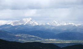 Snow Capped Mountains Shrouded in Storm Clouds Royalty Free Stock Images