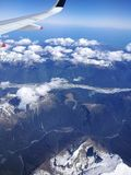 Snow-capped Mountains from Sky, Blue. Clouds, snow, mountains, bright blue Stock Images