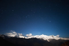 Snow-capped mountains and the stars Stock Images