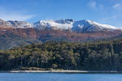 Snow capped mountains in the Strait of Magellan. Patagonia, Chile royalty free stock photography