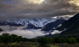 Snow-capped mountains at sunrise Royalty Free Stock Photography