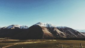 Snow Capped Mountains Under Blue Sky Stock Photography