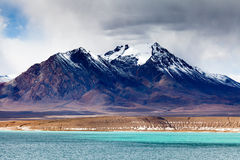 Snow-capped moutain by DangQiongCuo. Snow-capped moutain by TDangQiongCuo in Nagqu county Tibet Stock Photos