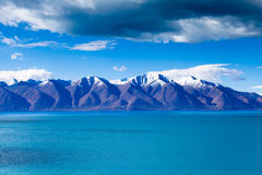 Snow-capped moutains in east lake shore of Tangra Yumco Stock Image