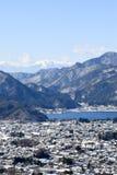 Snow capped Mt Mitsutouge beyond Lake Kawaguchiko royalty free stock photo