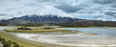 Snow capped Parinacota volcano. And Cotacotani lagoons, Lauca national park, northern Chile. The altitude of this volcano is 6348m above the sea Stock Photography