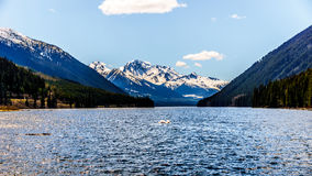 The snow capped peak of Mount Rohr at the south end of Duffey Lake. Duffey Lake is located along Highway 99 in the Coast Mountain Range, between Pemberton and Royalty Free Stock Image