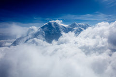Snow capped peak shrouded in clouds Stock Image