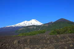 Snow capped peak of Volcano Llaima, Conguillio National Park, Chile. South America Royalty Free Stock Image