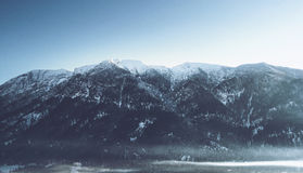 Snow-capped peaks in an alpine landscape Royalty Free Stock Images