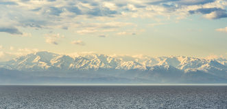 Snow-capped peaks of the Caucasus on  Black Sea. Snow-capped peaks of the Caucasus on the Black Sea Royalty Free Stock Photos