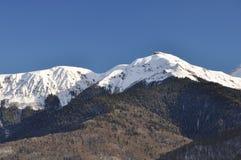 Snow-capped peaks of mountains Caucasus. Mountain ridge snow white sun winter Stock Photo