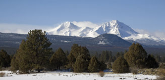 Snow capped peaks in winter Stock Photo
