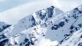Snow capped Rocky Mountain peak stock video