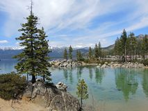 Snow Capped Sierras from Sand Harbor. Sand Harbor offers hiking trails and scenic overlooks where naturalists, photographers and hikers can take in the splendor Royalty Free Stock Images