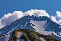 Snow-capped sopki. Alpine landscape. Canyon eastern slope of the West Sayan Range. Sayan mountains-a common name for two mountain royalty free stock photo