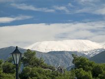 Snow-capped Summit from a Distance. A snow-capped summit of mount Parnassos, Greece, as seen from the town of Itea stock photo