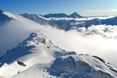 Snow capped summit of Tatry Stock Photos