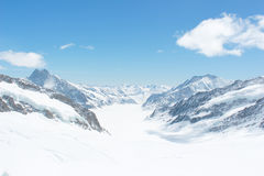 Snow capped Swiss Alps at Jungfrau, Switzerland. Snow capped mountains view at Jungfrau viewpoint which is called Top of Europe in Switzerland Royalty Free Stock Photography
